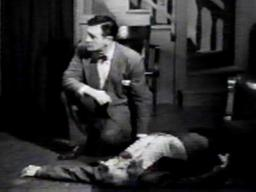 Harlan Briggs (on floor) with Richard Dix in 'Mysterious Intruder'