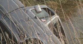 The wreckage of Kevin Anderson's fatal accident in 'A Thousand Acres'